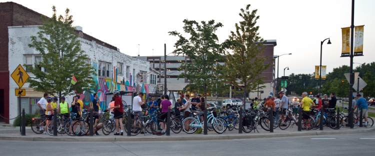 Cyclists gather to participate in the Bike BloNo Night Ride