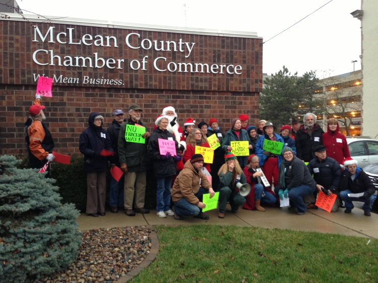 Illinois People's Action visits the McLean Co. Chamber of Commerce on the issue of fracking. Photo by Corey Mattson
