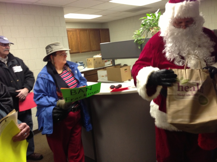 Santa gives lumps of coal to the McLean Co. Chamber. 12.17.12